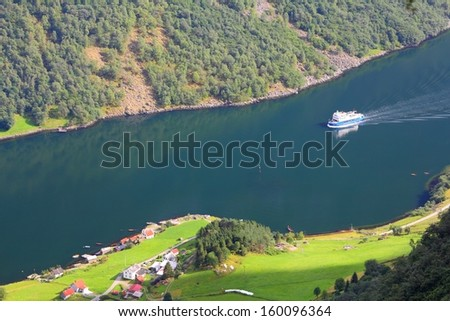 Naeroyfjord - famous UNESCO World Heritage Site in Norway. Beautiful fiord landscape in Sogn og Fjordane region. Aerial view of a ferry. - stock photo