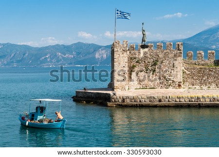 Nafpaktos, Greece - June 17, 2013: An unidentified fisherman leaves the harbor, going to work. Fishing in traditional boats remains an important part of the local economy in some parts of Greece.