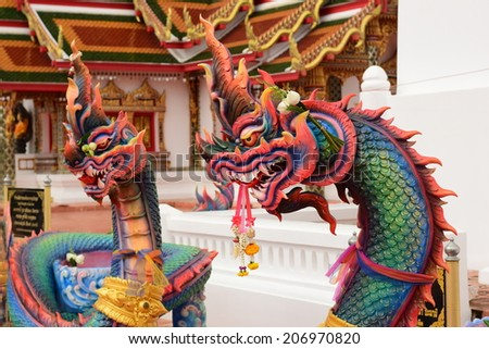 naga defender of buddha.in Thailand you can see naga in all temple - stock photo