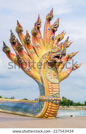 Naga sculpture was decorated with glazed tile in front of the sanctuary in Ban Rai temple, Korat, Thailand - stock photo