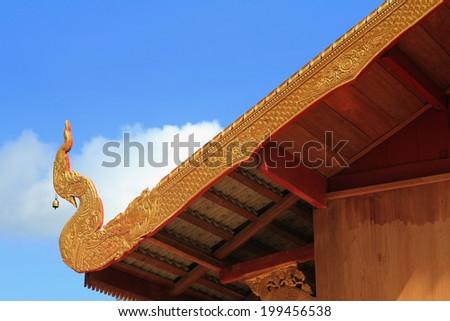 Naga statue protecting the entrance to Thai temple - stock photo
