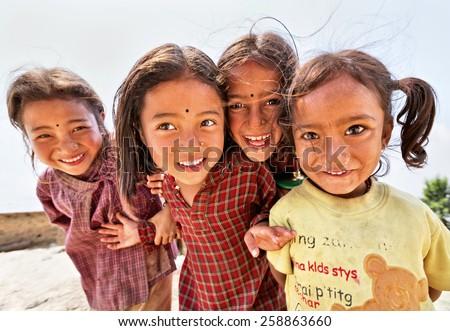 NAGARKOT, NEPAL - APRIL 5: Portrait of unidentified playful little Nepalese girls on April 5, 2009 in Nagarkot Village, Kathmandu, Central Region, Nepal. - stock photo