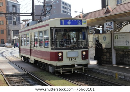 NAGASAKI, JAPAN - MARCH 30: An electric tramway from the Nagasaki Denki Kido company on March 30, 2011. The company was founded on August 2, 1914, and currently offers the lowest fares in the country.