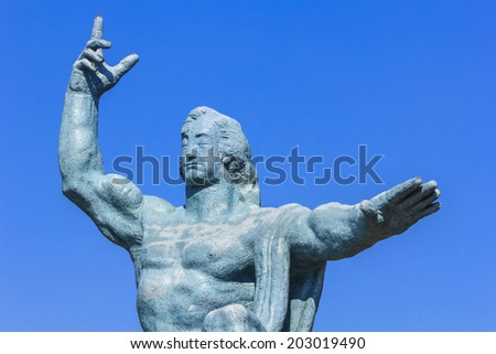 NAGASAKI, JAPAN - NOVEMBER 14: Nagasaki Peace Statue in Nagasaki, Japan on November 14, 2013. The statue's right hand points to the threat of nuclear, the extended left hand symbolizes eternal peace