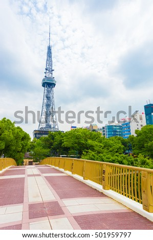 Nagoya, Japan - July 3, 2015: View over a footbridge in Hisaya Odori Park at the Nagoya TV Tower in city center on an overcast day