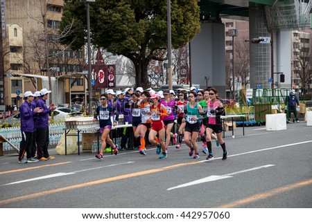 NAGOYA, JAPAN - MARCH 13, 2016: Nagoya Women's Marathon 2016.  Women's running in the downtown.,in motion blur. Course Start and finish at Nagoya Dome Distance 42.195km. Nagoya city Japan.