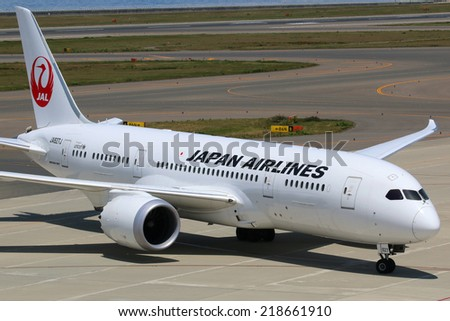 NAGOYA, JAPAN - MAY 23: A Japan Airlines Boeing 787 Dreamliner taxis on May 23, 2014 in Nagoya. The Boeing 787 Dreamliner is the world's first airliner to use composite materials in the construction. - stock photo
