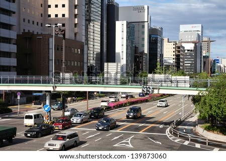 NAGOYA, JAPAN - MAY 3: People drive in heavy traffic on May 3, 2012 in Nagoya, Japan. With 589 vehicles per capita, Japan is among most motorized countries worldwide, which causes heavy traffic.