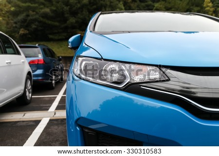 Nagoya, Japan - October 11, 2015:  Front light of a modern sports car on October 11, 2015 in Nagoya, Japan. Head lights of a sport car.