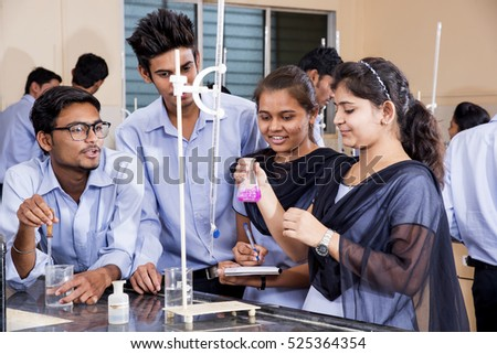 NAGPUR, MAHARASHTRA, INDIA, 9 APRIL 2016 : Unidentified Science Students conducting an experiment and studying together in a laboratory.