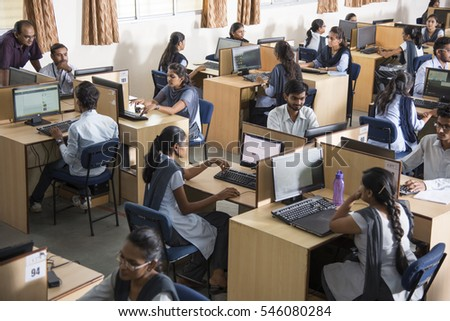 wide angle view busy design office. wide angle view of busy design office with workers at desks nagpur maharashtra india 11 april 2016 unidentified young students information a