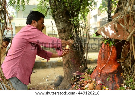 "NAGPUR, MAHARASHTRA, INDIA - AUGUST 01 : People worship of Snake God in ""Nag Panchami"" festival. It is traditional worship of snakes or serpents observed by Hindus in Nagpur, India on 01 August 2014"