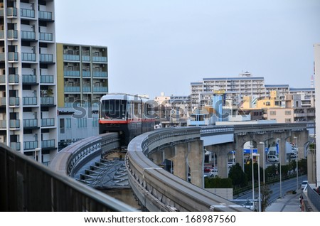 NAHA CITY, OKINAWA, JAPAN - NOVEMBER 26: The monorail in Naha approaches a station at Naha City at the japanese island Okinawa. Photo is taken on November 26, 2013 i Naha City, Okinawa, Japan.