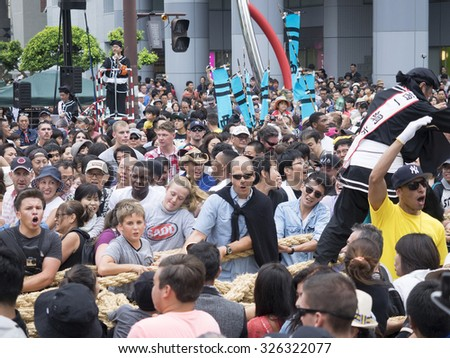"Naha, Japan - October 11, 2015: Naha Giant Tug of War at 2015. ""Tug of war"" are held throughout the island as thanksgiving for an abundant harvest and a prayer for rain, with a history of 560 years."