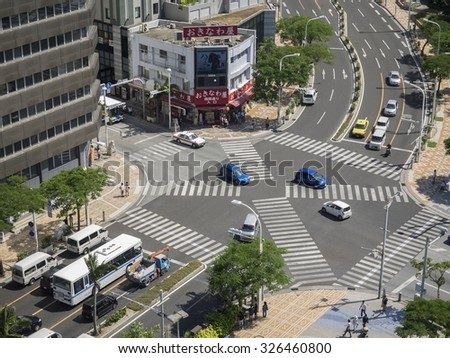 "Naha, Japan - October 12, 2015: This intersection is entrance of the ""Kokusai Dori"". ""Kokusai Dori"", literally ""International Road"" is Naha's main street. A lot of foreign tourists visit."