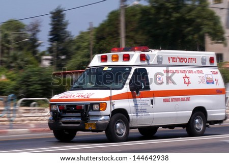 NAHARIYA, ISR - JULY 26:Israeli Magen David Adom ambulans on July 26 2006.Since June 2006, Magen David Adom has been officially recognized by the Red Cross (ICRC)as the national aid society of Israel. - stock photo