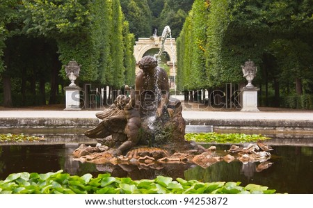Naiad fountain in the round pool of the Schönbrunn Palace, as nymphs of springs and streams, naiads were followers of Neptune. And the statue represents a naiad playing with a waterbird.