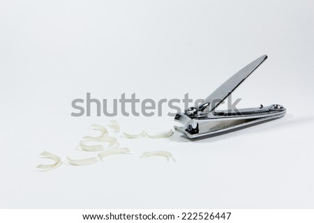 nail clipper with nasty nails on white background