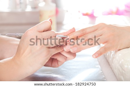 Nail gel salon. cuticles care with cuticle pusher.  - stock photo