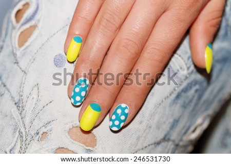 Nail Polish. Art Manicure. Colored Nail Polish. Beauty hands. Stylish Colorful Nails - stock photo