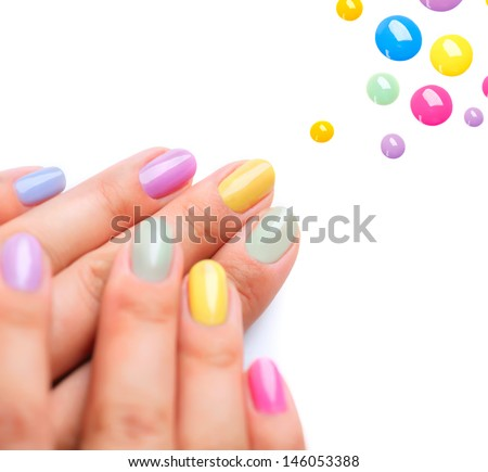 Nail Polish. Art Manicure. Multi-colored Nail Polish. Beauty hands. Stylish Colorful Nails  - stock photo