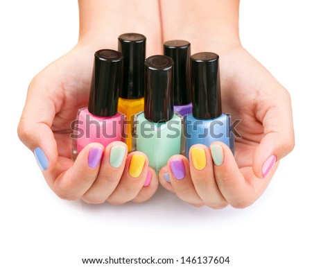 Nail polish hand stock images royalty free images vectors nail polish art manicure multi colored nail polish bottles in the hands prinsesfo Images