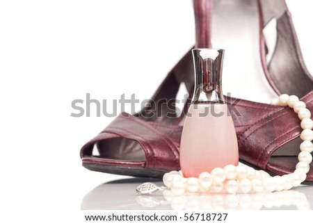 Nail Polish Bottle with Pearls and Ladies Shoes - stock photo