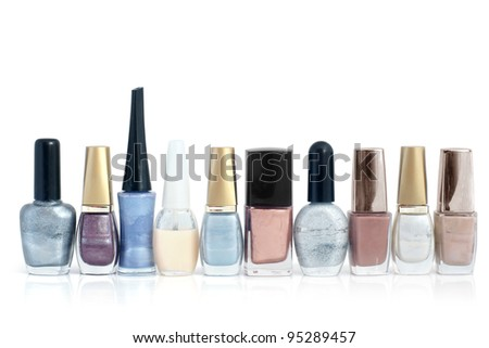 Nail polish bottles in a row on a white background