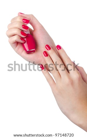 Nail polish in woman hand isolated on white - stock photo
