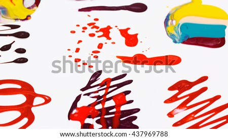 Nail polish (varnish) mixed multicolor blots over white