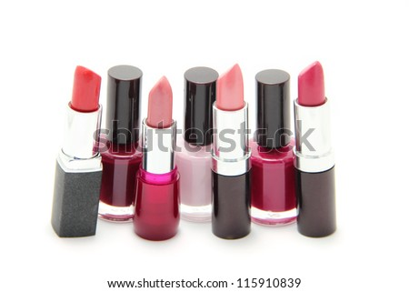 Nail polishes and lipsticks of different shades isolated on white