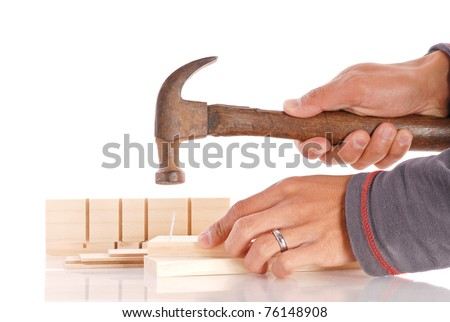 Nailing Two Parts Together - stock photo
