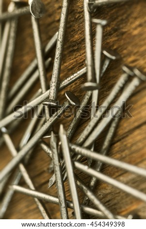 Nails on wooden background/ Nails on wooden background
