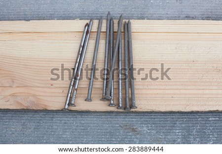 nails on wooden board - stock photo