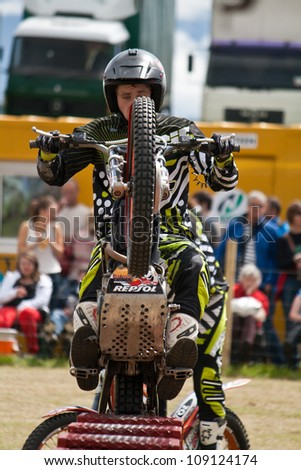NAIRN, SCOTLAND - JULY 28: Matthew Alpe from the Inch Perfect Trials Display Team performs at the annual Nairnshire Farmers Show on JULY 28, 2012 in Nairn, Scotland - stock photo