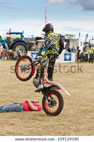 NAIRN, SCOTLAND - JULY 28: Matthew Alpe from the Inch Perfect Trials Display Team performs at the annual Nairnshire Farmers Show on JULY 28 2012 in Nairn, Scotland - stock photo