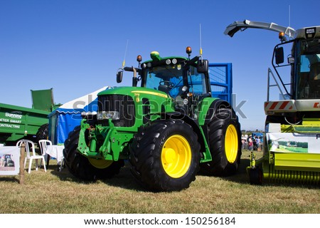 NAIRN, SCOTLAND - JULY 27: New John Deere 7530 tractor on display at the annual Nairn Farmers Show on July 27, 2013 in Nairn, Scotland - stock photo
