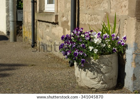 NAIRN, SCOTLAND - June, 2013: Street in Nairn, Scotland on a sunny summer day