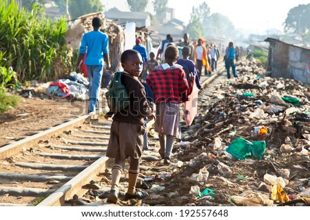 NAIROBI, KENYA - FEBRUARY 6, 2014: Children living in the slums of Kibera on February 6, 2014 in Nairobi, Kenya. The largest slum of Africa is in Nairobi. About 270 thousand people living in Kibera. - stock photo