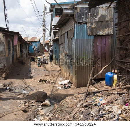 NAIROBI, KENYA- NOVEMBER 7, 2015: Unidentified people live in extreme poverty in Kibera, Africa's largest urban slum - stock photo