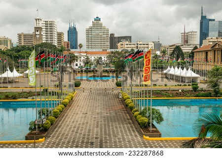 NAIROBI, KENYA - OCTOBER 20, 2014 : Courtyard surrounding the Jomo Kenyatta statue in front of the Kenyatta International Conference Centre in the central business district of Nairobi - stock photo