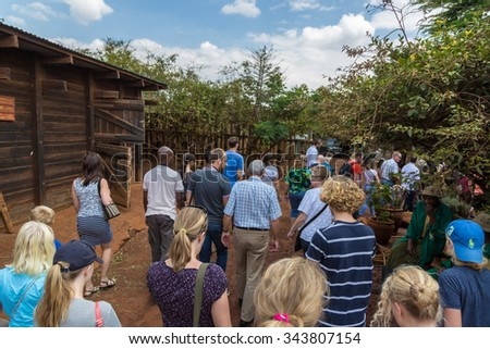 Nairobi, Kenya - October, 1st 2015 - Big group of locals and tourists arriving in the Sheldrick Trust Elephant Orphans Project in a cloudy day at Nairobi, Kenya's capital, east Africa. - stock photo