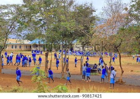 NAIROBI, KENYA - OCTOBER 13: Unidentified children play in school yard on 13 October 2011 in Nairobi, Kenya. Kibera is the largest slum in Nairobi, and the second largest urban slum in Africa - stock photo