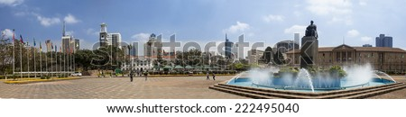 NAIROBI, KENYA-SEPTEMBER 17 2014: Unidentified lawmakers and tourists go about their business at the judiciary, Nairobi Kenya. Picture is 180 degree panorama - stock photo
