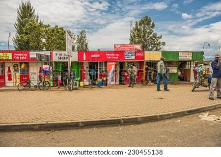 NAIVASHA, KENYA - OCTOBER 18, 2014: Typical shopping street scene with pedestrians in Naivasha, Kenya - stock photo