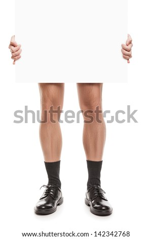 Naked adult man in black socks and shoes hand holding blank placard white isolated - stock photo