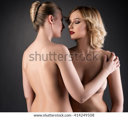 Naked blonde women hugging in front of camera