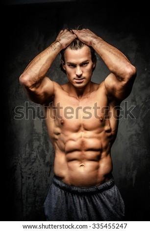 Naked Young Male Bodybuilder Holding Blank Board Stock