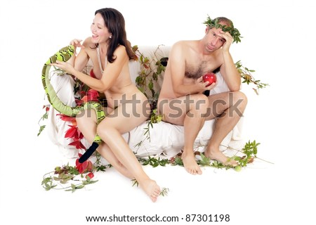 naked couple sitting on couch, woman and snake, man and red apple - stock photo