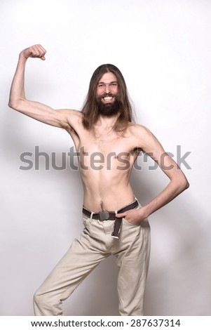 Naked dystrophic man smiling. Man in cream trousers with his hand in pocket. - stock photo